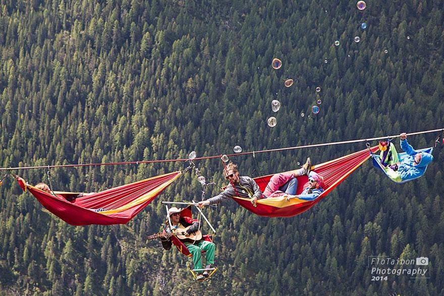 Adventurers Relax in Hammocks Hanging Hundreds of Feet